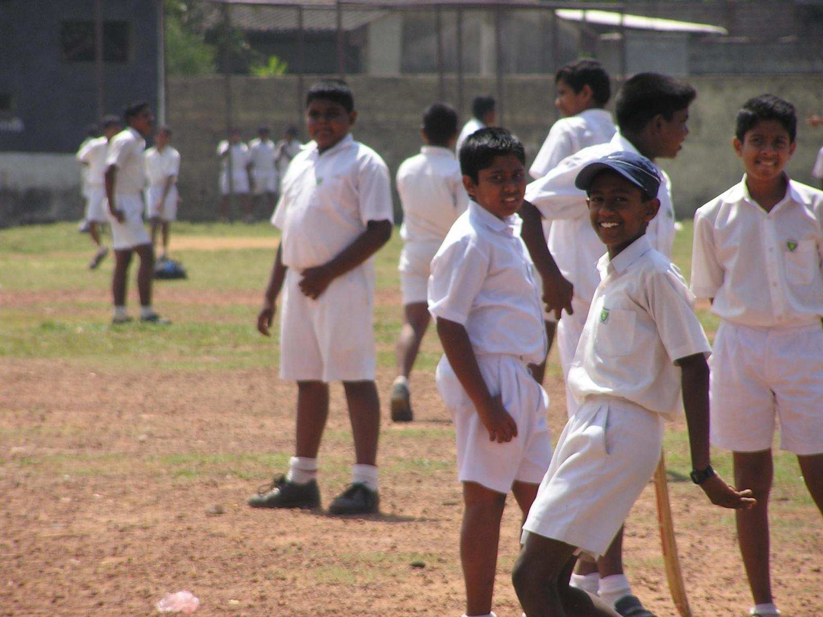 A group of children prepare for their physical education lesson through our volunteer sports coaching project in schools in Sri Lanka.